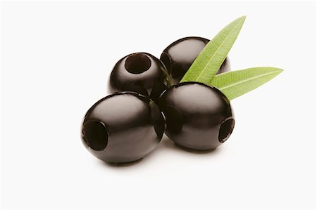 Large Black Olives on a White Background Stock Photo - Premium Royalty-Free, Code: 659-06494461