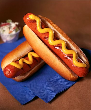 spicy - Two Grilled Hot Dogs with Mustard Stock Photo - Premium Royalty-Free, Code: 659-06494482