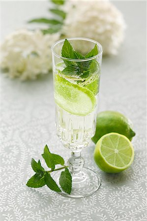 Hugo (a cocktail with elderflower syrup, champagne and limes) Stock Photo - Premium Royalty-Free, Code: 659-06495000