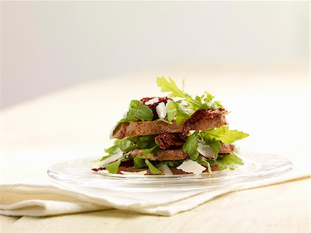 recipe - Bread salad with rocket and dried tomatoes Stock Photo - Premium Royalty-Free, Code: 659-06495069