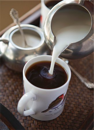 pouring - Milk being poured into a cup of coffee Stock Photo - Premium Royalty-Free, Code: 659-06495097