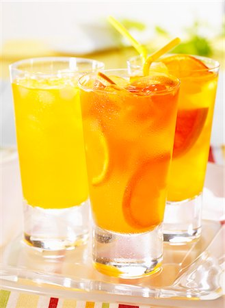 drink (non-alcohol) - Three tangerine and grapefruit drinks Stock Photo - Premium Royalty-Free, Code: 659-06495307