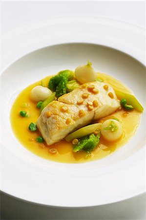 Bass in a saffron sauce with Savoy cabbage, young turnips and yellow split peas Stock Photo - Premium Royalty-Free, Code: 659-06495477
