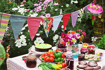 decorations - A table laid in a garden with biscuits, fresh vegetables, jam and cake Stock Photo - Premium Royalty-Free, Code: 659-06493671