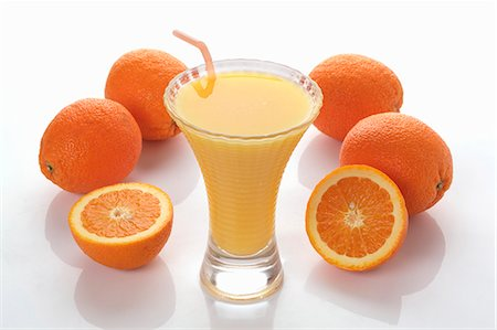 An orange smoothie and fresh oranges Stock Photo - Premium Royalty-Free, Code: 659-06493960