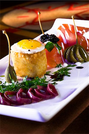 food - Salmon with a Quail Egg, Roe, Caper Berries and Balsamic Dressing Stock Photo - Premium Royalty-Free, Code: 659-06670875