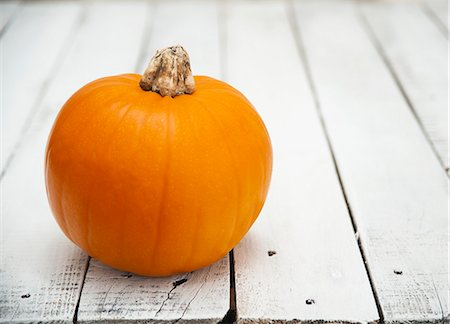 A pumpkin on a wooden table Stock Photo - Premium Royalty-Free, Code: 659-06670994