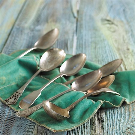 Assorted Silver Spoons on Felt Cloth Stock Photo - Premium Royalty-Free, Code: 659-06671101