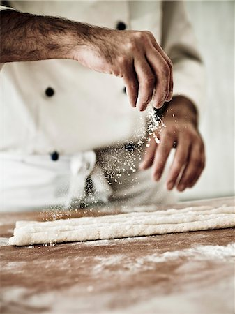 A chef dusting gnocchi dough with flour Stock Photo - Premium Royalty-Free, Code: 659-06671138