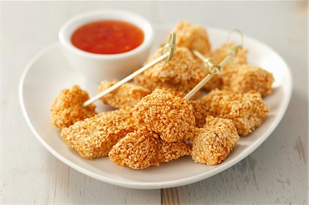 snack - Chicken with a sesame crust and chilli sauce Stock Photo - Premium Royalty-Free, Code: 659-06671130