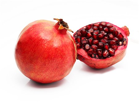 A whole and half pomegranate Stock Photo - Premium Royalty-Free, Code: 659-06671319