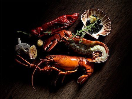 A still life including lobster, olives and thyme Stock Photo - Premium Royalty-Free, Code: 659-06671438