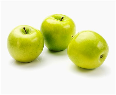 Three apples of the variety 'Granny Smith' Stock Photo - Premium Royalty-Free, Code: 659-06671617
