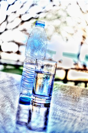 effect - A bottle of water and a glass of water on a table Stock Photo - Premium Royalty-Free, Code: 659-06901439