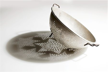 stars on white background - Antique Metal Colander with Shadow Stock Photo - Premium Royalty-Free, Code: 659-06901583