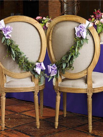 flower decor design - Chairs Decorated with Fresh Garland and Ribbon for the Bride and Groom at a Wedding Reception Stock Photo - Premium Royalty-Free, Code: 659-06901599