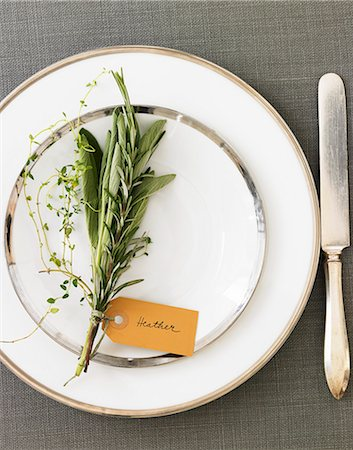 set - Place Setting with a Bouquet of Herbs and a Name Tag Stock Photo - Premium Royalty-Free, Code: 659-06901593