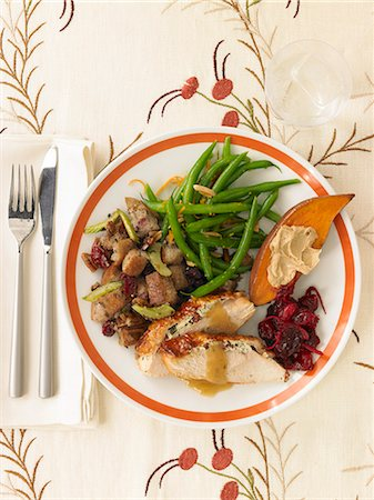 set - Thanksgiving Plate with Turkey, Pecan Cherry Stuffing, Green Beans, Sweet Potato and Cranberry Sauce Stock Photo - Premium Royalty-Free, Code: 659-06901615