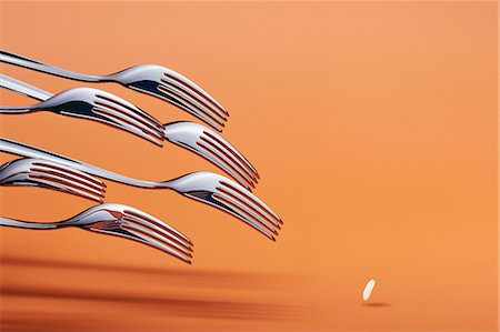 fork - Forks and a grain of rice Stock Photo - Premium Royalty-Free, Code: 659-06901650