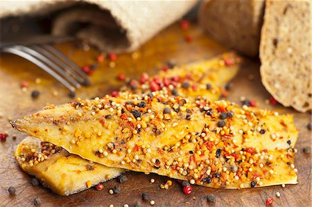 smoked - Smoked mackerel fillet (North Atlantic) spiced with pepper, paprika and mustard seeds Stock Photo - Premium Royalty-Free, Code: 659-06901752