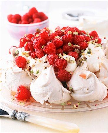 dessert - Pavlova Topped with Whipped Cream, Raspberries and Powdered Sugar Stock Photo - Premium Royalty-Free, Code: 659-06901917