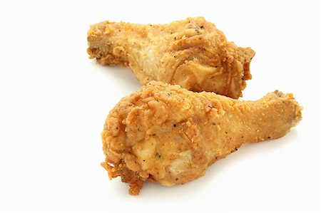 Two deep-fried chicken legs Stock Photo - Premium Royalty-Free, Code: 659-06902124