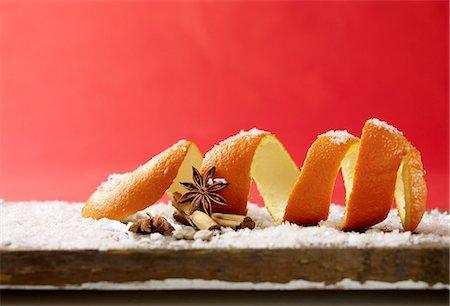 Still life with orange peel, cinnamon, star anise and powdered sugar Stock Photo - Premium Royalty-Free, Code: 659-06902354