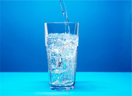 drinking water glass - Pouring mineral water into a glass Stock Photo - Premium Royalty-Free, Code: 659-06902408