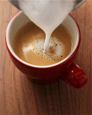 pouring - Milk foam being poured onto espresso Stock Photo - Premium Royalty-Free, Code: 659-06902568