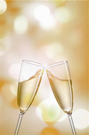 Clinking champagne glasses Stock Photo - Premium Royalty-Free, Code: 659-06902571
