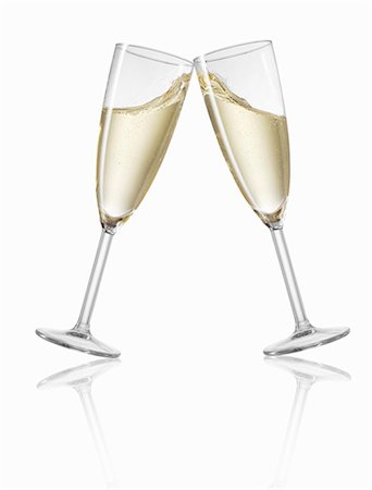 Clinking champagne glasses Stock Photo - Premium Royalty-Free, Code: 659-06902572
