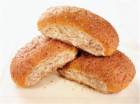 Three oval bread rolls Stock Photo - Premium Royalty-Free, Code: 659-06902591