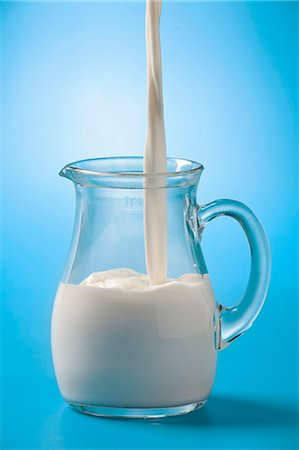 Pouring milk into a glass jug Stock Photo - Premium Royalty-Free, Code: 659-06902626