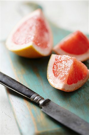 Grapefruit wedges Stock Photo - Premium Royalty-Free, Code: 659-06902708