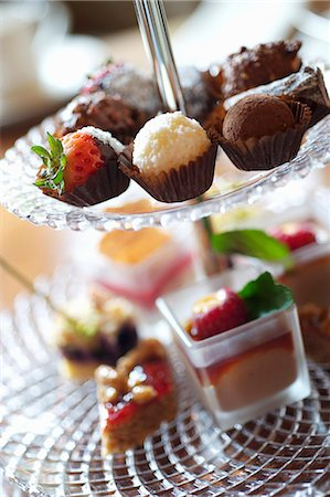 Assorted filled chocolates and miniature cakes Stock Photo - Premium Royalty-Free, Code: 659-06902849