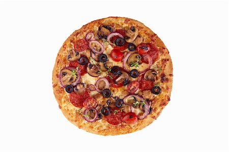 fungus - Whole Loaded Pizza on a White Background; From Above Stock Photo - Premium Royalty-Free, Code: 659-06902897