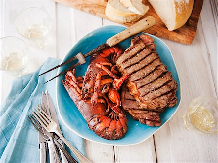 Surf and Turf Platter with Grilled Steak and Lobster; With Bread; From Above Stock Photo - Premium Royalty-Free, Code: 659-06903058