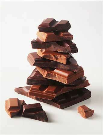 A stack of assorted chunks of chocolate Stock Photo - Premium Royalty-Free, Code: 659-06903112