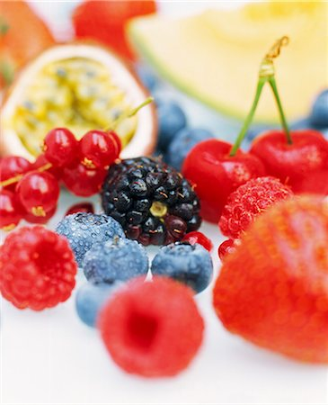 Close up of a selection of fresh fruits including blueberries, redcurrants, passion fruit, raspberries, blackberries, strawberries and cherries. Stock Photo - Premium Royalty-Free, Code: 659-06903132