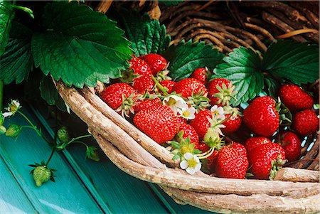 strawberries - Fresh strawberries with leaves in basket Stock Photo - Premium Royalty-Free, Code: 659-06903153
