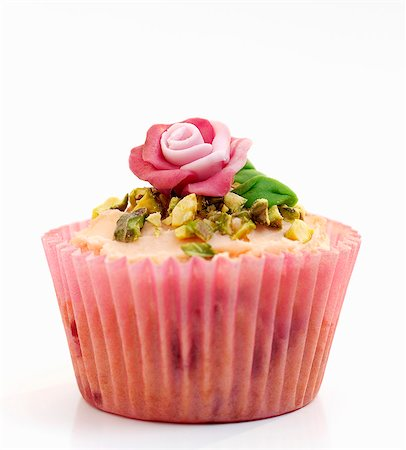 rose - A celebration cupcake decorated with pistachios and a marzipan rose Stock Photo - Premium Royalty-Free, Code: 659-06903318