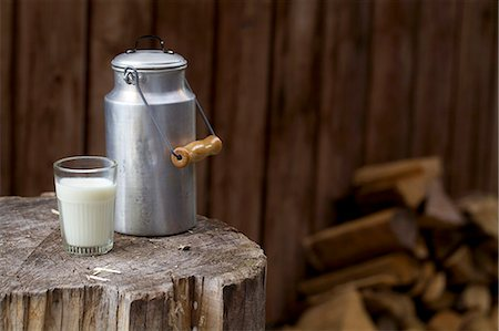 rustic - A milk churn and a milk glass on a rustic wooden block Stock Photo - Premium Royalty-Free, Code: 659-06903449