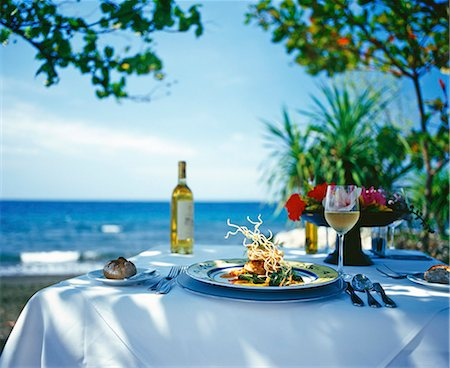 restaurant - A table laid for a meal by the sea in Bali Stock Photo - Premium Royalty-Free, Code: 659-06903460