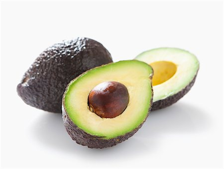 A whole and a halved avocado with no background Stock Photo - Premium Royalty-Free, Code: 659-06903544