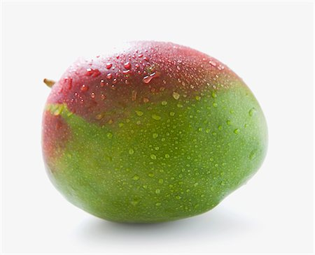 A mango with drops of water Stock Photo - Premium Royalty-Free, Code: 659-06903570