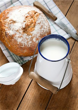 A fresh loaf of bread and a can of milk Stock Photo - Premium Royalty-Free, Code: 659-06903597