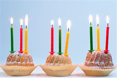 Three Bundt cakes with lit candles, for a birthday Stock Photo - Premium Royalty-Free, Code: 659-06903645