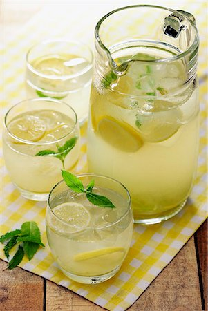 Homemade Country Lemonade garnished with some mint leaves, selective focus Stock Photo - Premium Royalty-Free, Code: 659-06903968