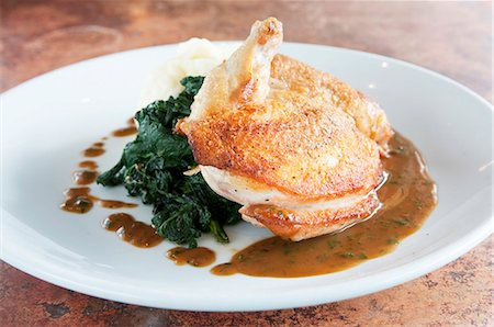recipe - Roasted Chicken with Wilted Spinach and Gravy Stock Photo - Premium Royalty-Free, Code: 659-07026785