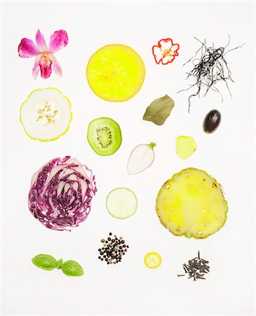 effect - Assorted Slices of Vegetables, Fruit, Herbs and Seeds on a White Background Stock Photo - Premium Royalty-Free, Code: 659-07026815